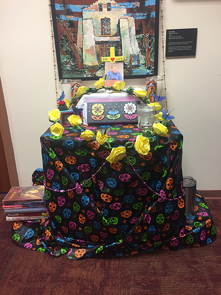 Photo of a colorful altar erected in Luis Leon's honor in the Department of Religious Studies at the University of Denver