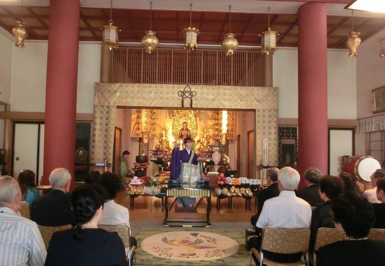 Rev. Ikuko Hibino, the female chief priest of the Kayadera Temple, leading parishioners at the temple in Kuramae, Tokyo.