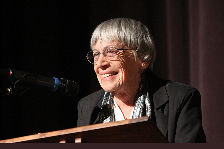 Ursula Le Guin speaks at a podium in 2013. Photo by Jack Liu.