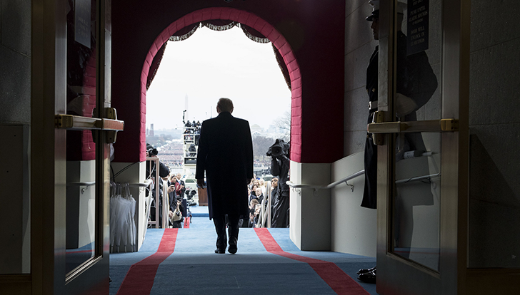 Shot from behind him, Trump walking out from the capitol building to being inaugurated as president on Jan 20, 2017.