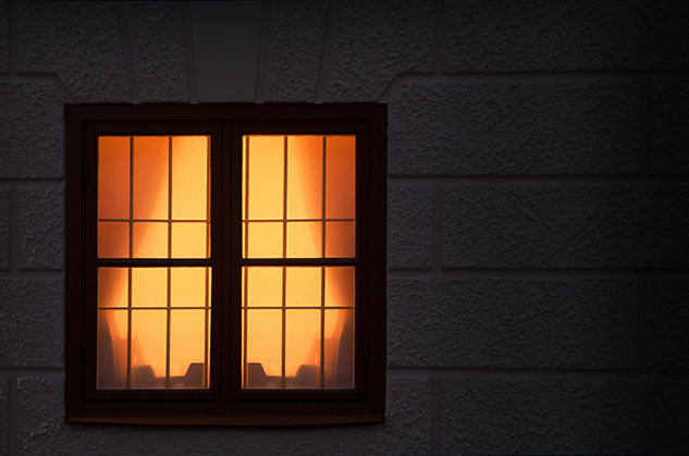 A lit interior window at night