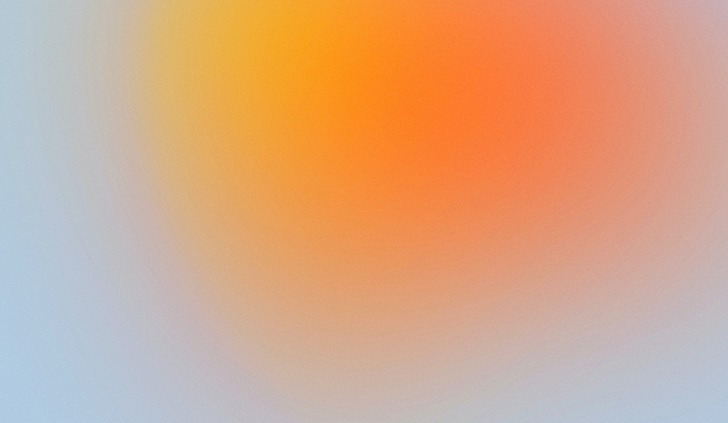 abstract image of a yellow and orange circle blurring into a light blue background