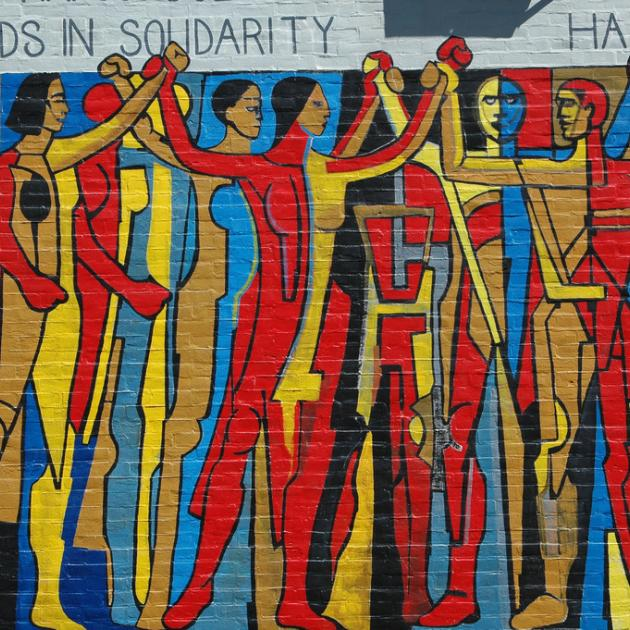 Hands in Solidarity, Hands of Freedom mural on the side of the United Electrical Workers trade union building on West Monroe Street at Ashland Avenue in Chicago, Illinois.