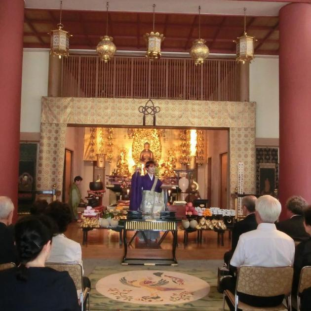 Rev. Ikuko Hibino, the female chief priest of the Kayadera Temple, leading parishioners at the temple in Kuramae, Tokyo.