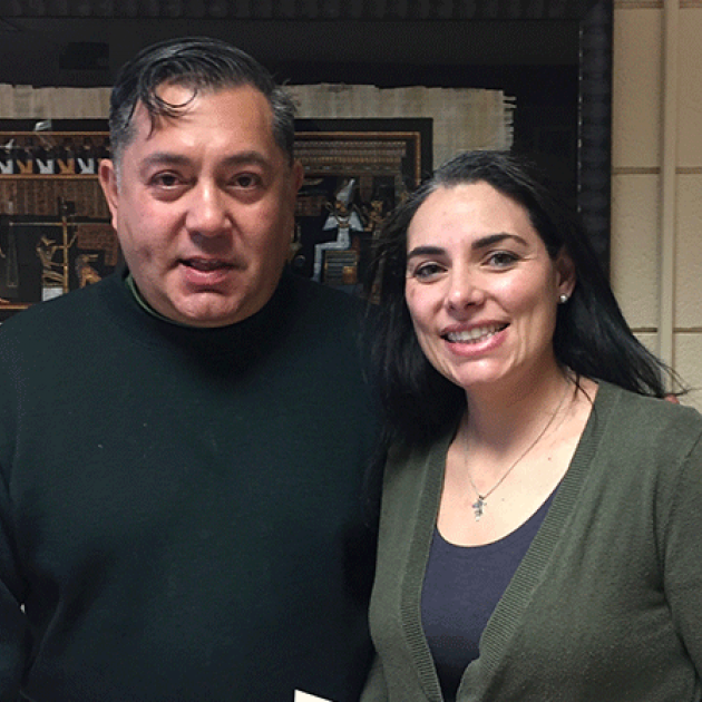 photo of Luis Leon posing with student Elaine Penagos in December 2016