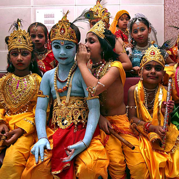 Children dressed as Lord Krishna wait for a fancy dress competition. Credit: Ajay Verma/Reuters