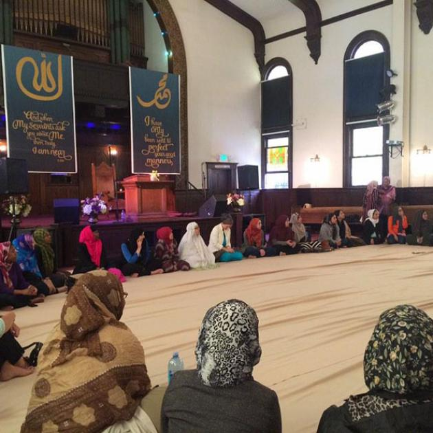 photo of women sitting in a large circle at the Women's Mosque of America