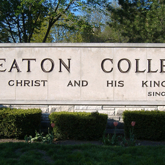 "Concrete and stone sign for Wheaton College on campus. It reads ""Wheaton College"" and ""For Christ and His Kingdom"""