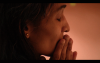 Close up shot of woman in prayer