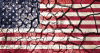 an image of an American flag sumperimposed on top of crecked, dried bed of clay