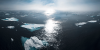 Ocean, broken ice, and a sunset off the coast of Greenland